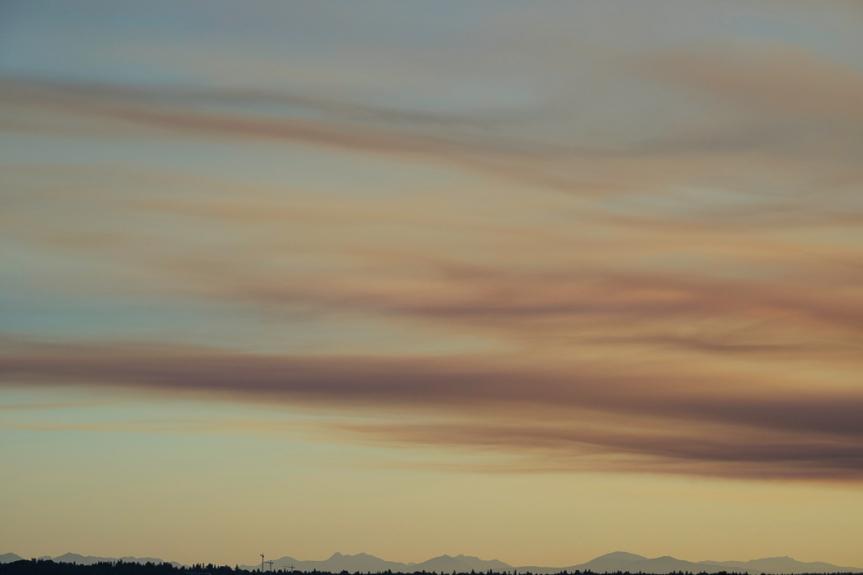pale pink smoke plumes over yellowish sky