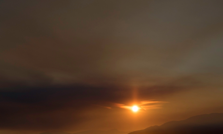 sunset with sun obscured by smoke
