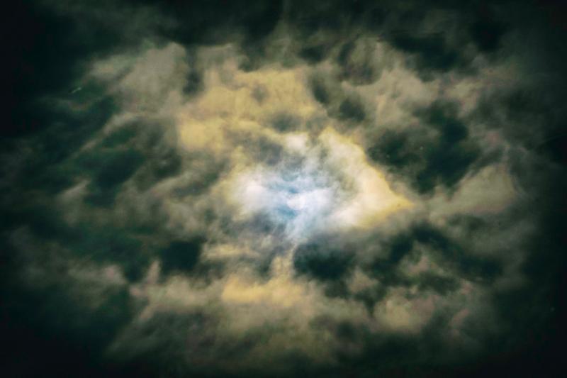 Sun in clouds in pond
